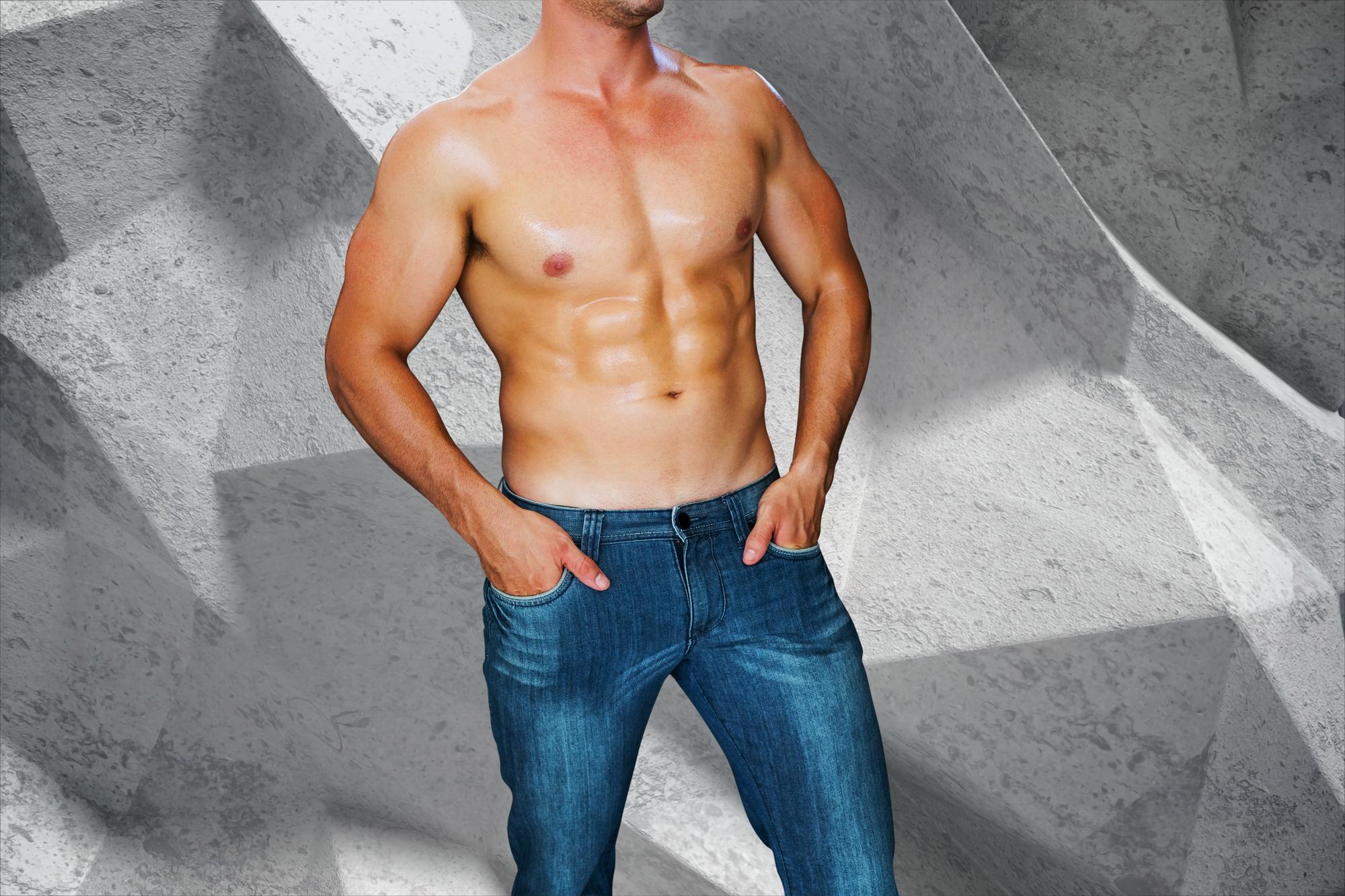 Attractive bodybuilder against grey angular background