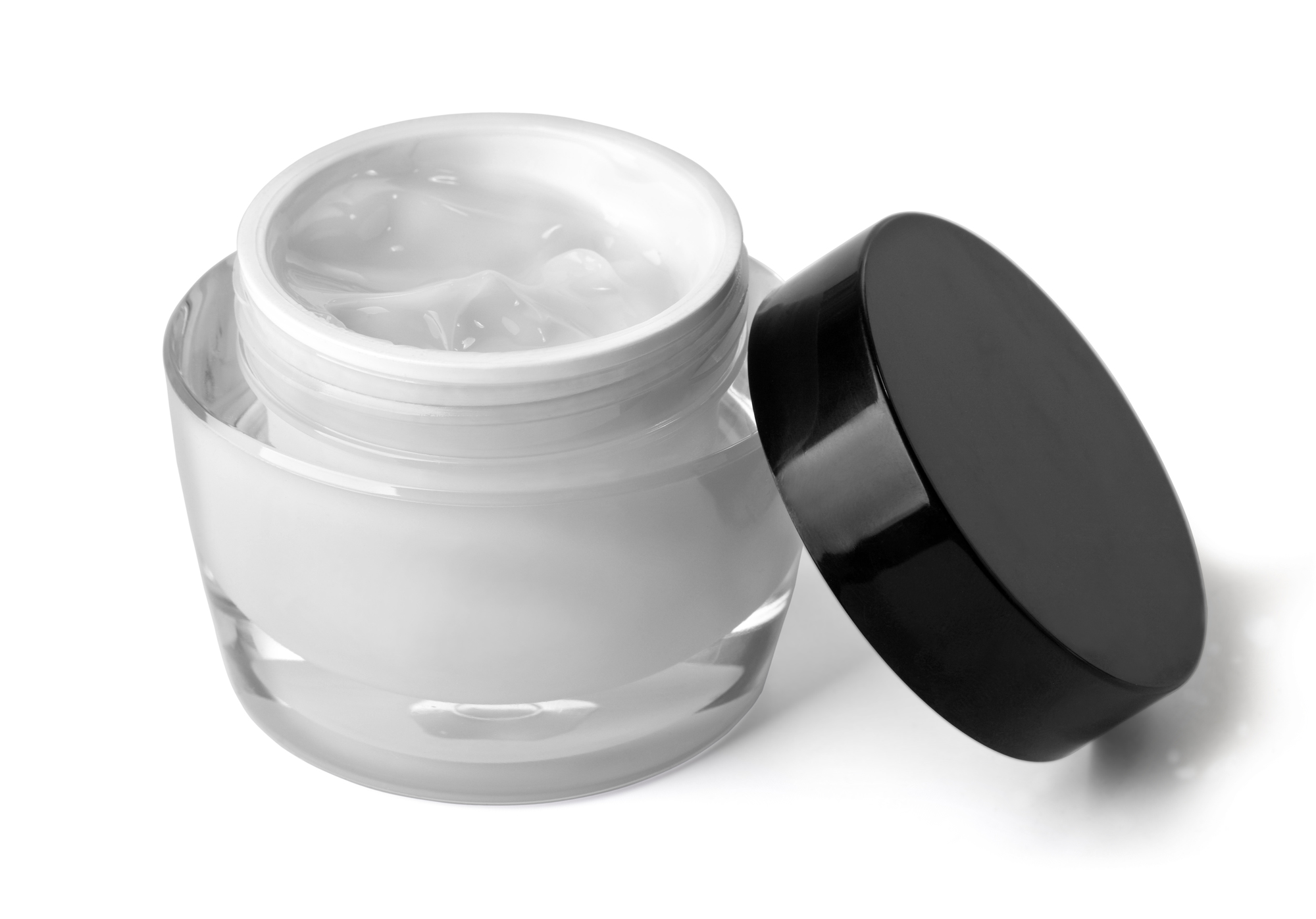 glass jar of beauty cream with cap, isolated on white with clipping path